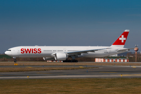 czech switzerland: PRAGUE, CZECH REPUBLIC - MARCH 28: Boeing B777-300ER of Swiss Airlines taxi for take off from PRG Airport in Prague on March 28, 2017. Swiss International Air Lines is the flag carrier airline of Switzerland.