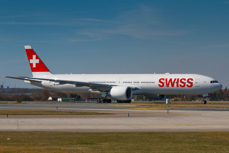 PRAGUE, CZECH REPUBLIC - MARCH 28: Boeing B777-300ER of Swiss Airlines taxi for take off from PRG Airport in Prague on March 28, 2017. Swiss International Air Lines is the flag carrier airline of Switzerland.
