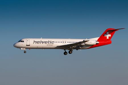 czech switzerland: PRAGUE, CZECH REPUBLIC - JUNE 16: Fokker F100 of Helvetic Airways landing at PRG Airport in Prague on June 16, 2017. Helvetic Airways is a Swiss airline based at Zurich Airport.