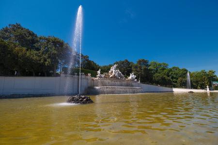 schoenbrunn: Vienna, Austria - 29 May, 2017: The biggest fontaine in the Schonbrunn Palace Garden Editorial