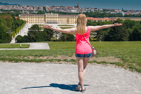 Vienna, Austria - 29 May, 2017: Schonbrunn Palace with women in Vienna, 29. May,2017. The former imperial summer residence is a UNESCO World Heritage site. Editorial