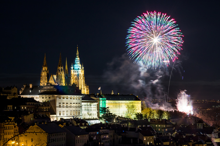 Celebration of New Year in centre in Prague with fireworks over Prague Castle