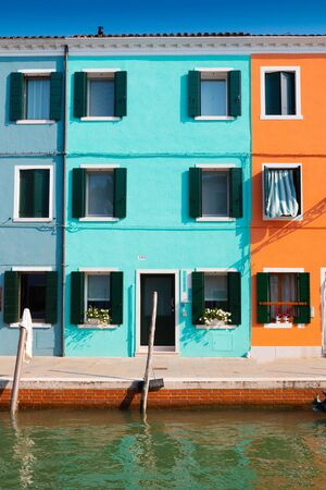 Venice, Italy - September 15, 2019: Burano island, famous for its colorful fishermen's houses, in Venice, Italy