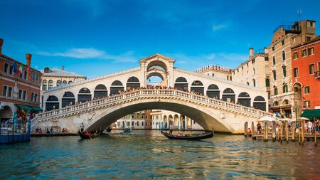 Venice, Italy - September 16,2019. The Rialto Bridge is the oldest of the four bridges spanning the Grand Canal in Venice, Italy.