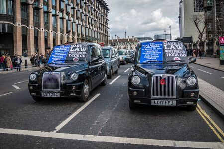 London, Great Britain - March 18, 2019: Black cab driver on Bridge street near the Parliment protesting.