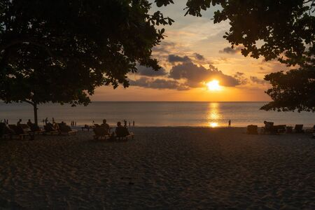 Sunset over the sea on the beach in Jimbaran, Bali.