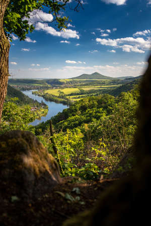 View on river Elbe with hill Milesovka in Central Bohemia Uplands
