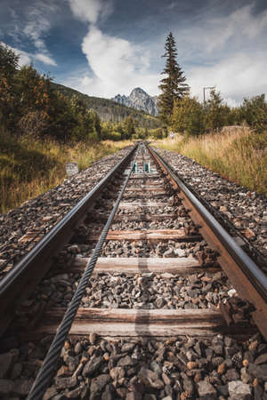 Rail track with Lomnicky peak in background in High Tatras, Slovakia