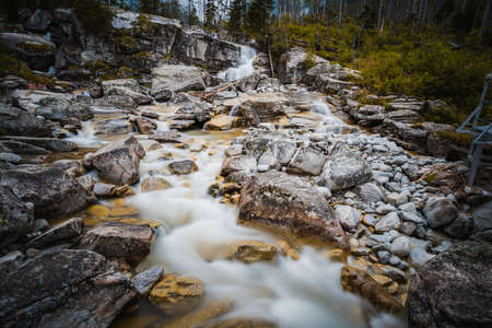 The Cold Creek flows through a huge terrain break and creates beautiful cascades and cataracts. Фото со стока