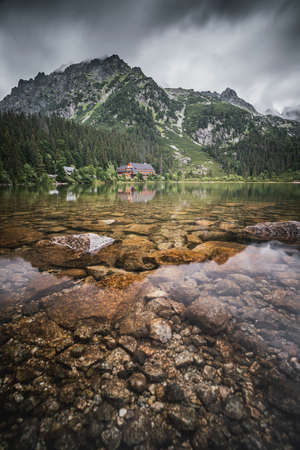 Popradské pleso (once called Rybie pleso) is a mountain lake of glacial origin located in the High Tatras, Slovakia. Фото со стока