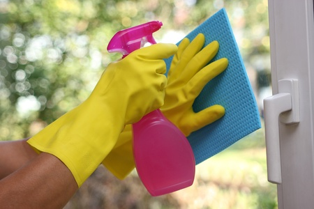 clean hands: Cleaning windows Stock Photo