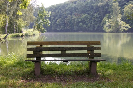 reported: bench on a lake Stock Photo