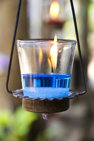Calming the Nerves with blue aromatic Candle in spa.