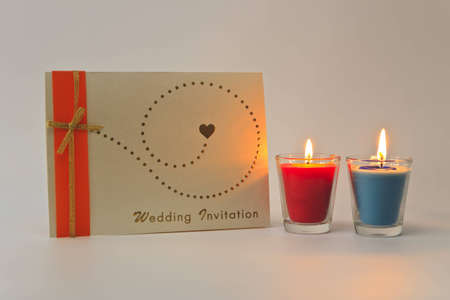 Wedding invitation card and aromatic candle. photo