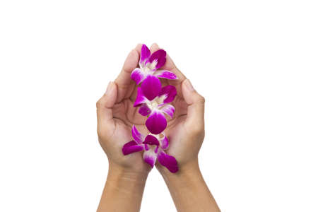 hands with orchid flower