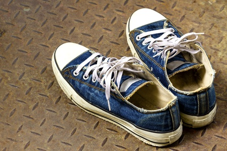 Old shoe on the Iron ground Stock Photo
