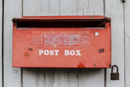 Old red post box photo