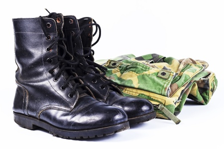Military camouflage uniforms and boots Through use.