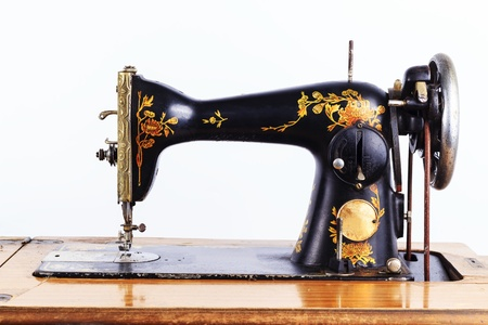 The old sewing machine on a white background photo