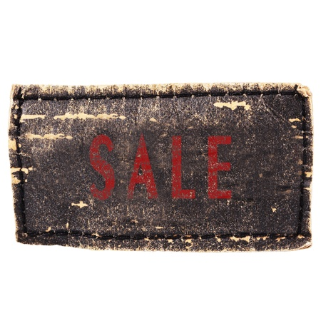 zigzagger: Sale text at jeans label isolated on white Stock Photo