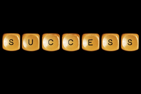 Grunge typewriter keyboard play on  success words . Isolated on a black background. Stock Photo