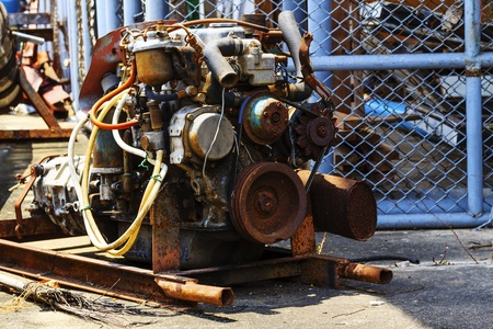 An old engine in  Repair garage  Stock Photo