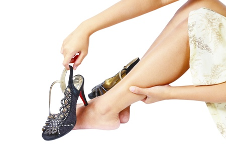leg pain: Women wearing high heels shoes, sitting  and massaging tired legs Stock Photo