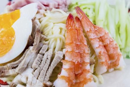 Japanese ramen noodles with  shrimp, pork, ham and eggs. photo
