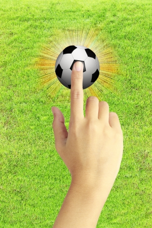 hand and a soccer ball photo