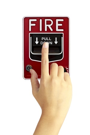 ring of fire: Hand is pushing fire alarm switch