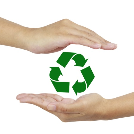 recycle sign in hand. photo