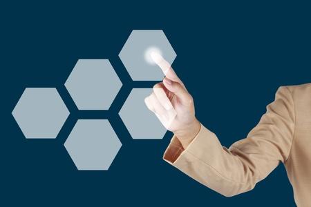 woman finger push button on virtual screen photo