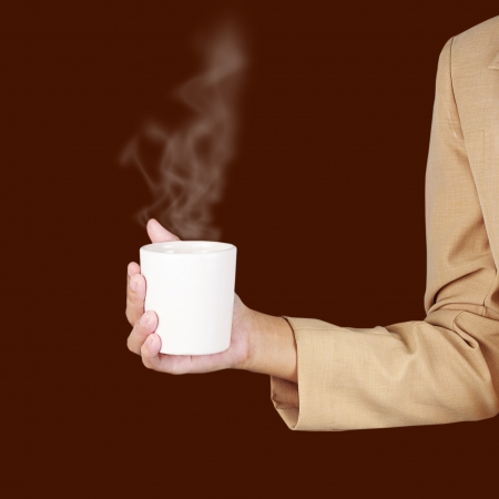Business woman holding a cup of coffee in hand  photo