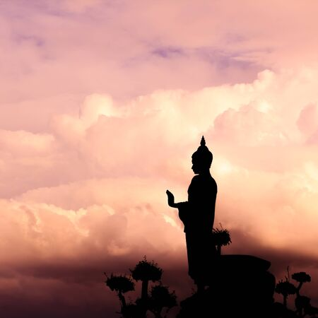 Buddha silhouette on sunset sky  photo
