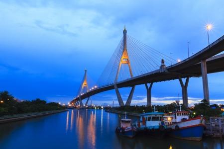 Architecture of Mega Bhumibol Industrial Ring Bridge at dusk in Thailand.