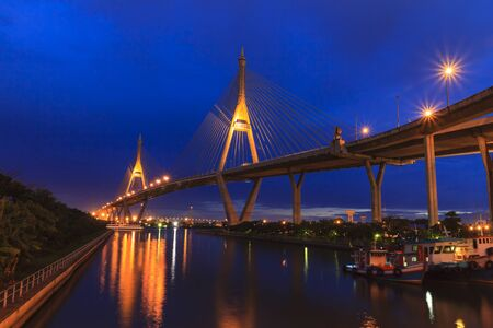 Architecture of Mega Bhumibol Industrial Ring Bridge at dusk in Thailand.