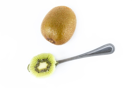 Ripe kiwi fruits with half on white background photo