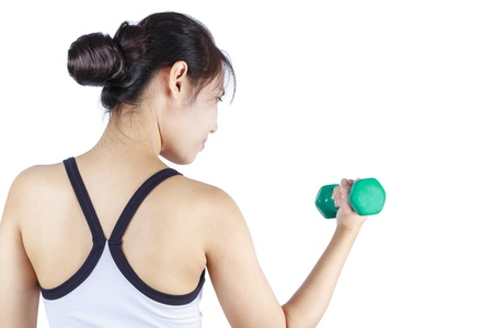 Young asian woman lifting a dumbbell Stock Photo - 15005946
