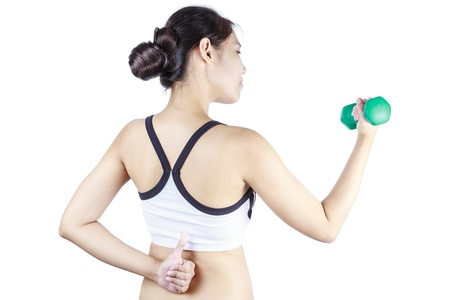 Young asian woman lifting a dumbbells photo