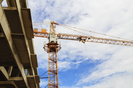 A construction site with a crane and blue sky photo