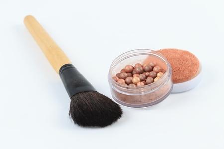 meteorites: Make-up.Makeup meteorites powder over white