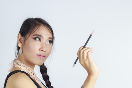 Asian women writing something Stock Photo - 15544537