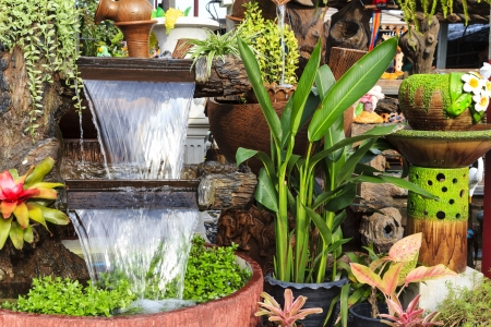 beauty fountain: Decorative garden with waterfall  Stock Photo