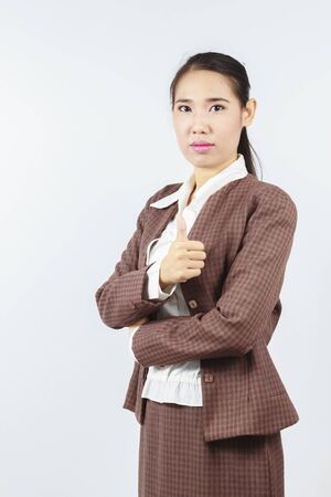 Attractive Asian business woman with thumb up