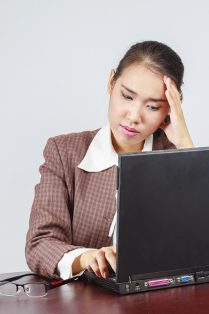 A depressed Asian businesswoman in her office photo