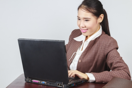 Young business woman working at office Stock Photo - 15921812