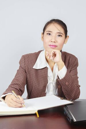 Portrait of beautiful young business woman sitting at desk at office Stock Photo - 15921813