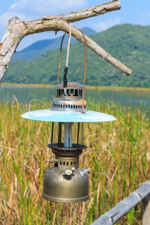 A hurricane-lamp hanging on the dried tree photo