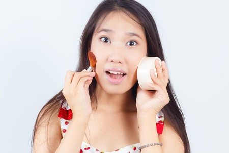 Portrait of Asian women attractive applying blusher
