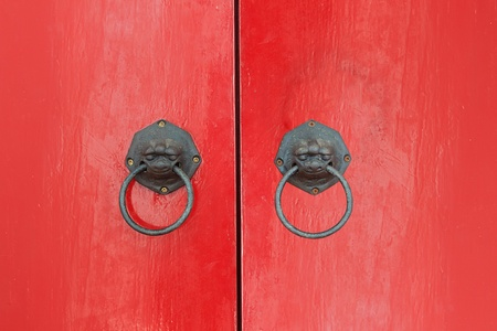 The Vintage knocker of old  lion  on red door photo